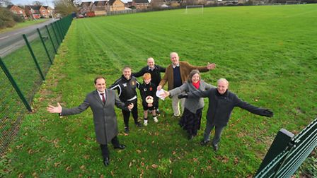 Representatives of the organisations behind the Hethersett Olympic Legacy Sports Complex gather on t