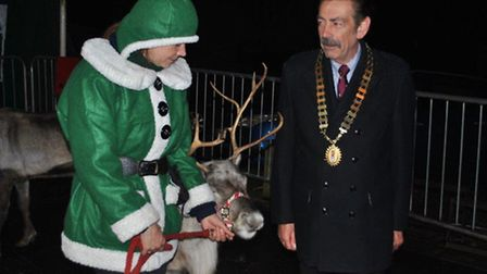 Thorpe St Andrew Christmas lights switch-on.Town Mayor John Ward with the reindeer.