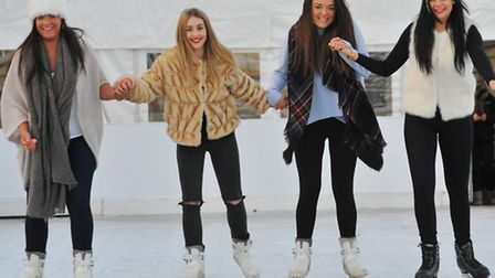 Having fun on the ice rink in the Castle Gardens, Norwich. Left to right Karina Wilson, Jolie Harvey