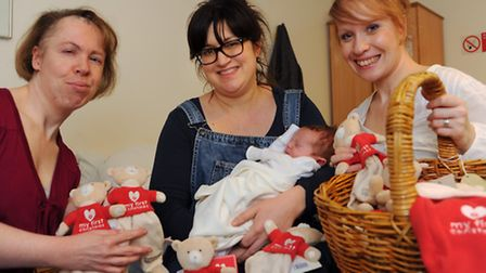 Sisters, Claire Webster, left, and Lianne Smith, right, who started Mummy's Little Bundle, give out