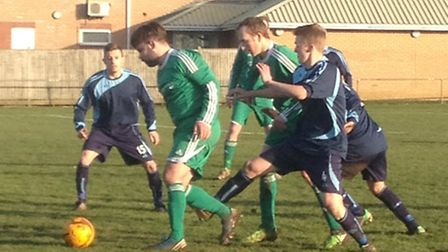 Action from Watton United's 4-1 win at St Andrews Reserves.
