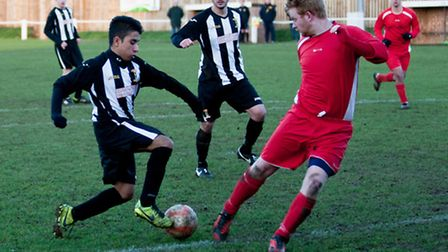 Ahmed Rhaouti turns his man to press the attackt in Swaffham Reserves' 4-2 win against South Walsham