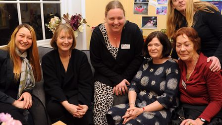 Harriet Harman, 2nd left, shadow deputy prime minister, meets volunteers and service users at the Wo