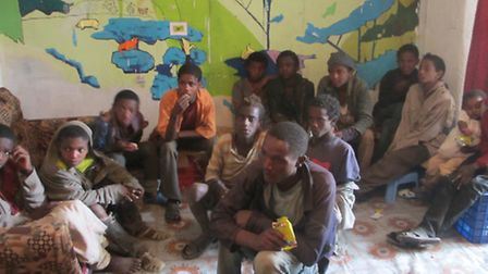 The street kids of Addis Ababa in Ethiopia watching How To Train Your Dragon