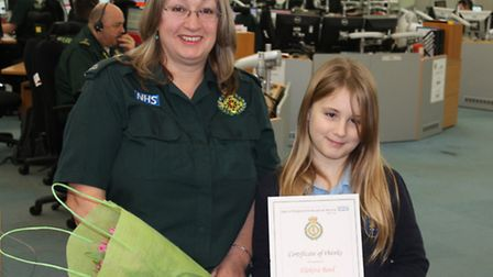 Nine-year-old Elektra Reed receives her certificate from call handler Erica Crowe. Picture: SUBMITTE