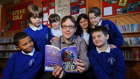 Author Ben Scott at Angel Road Junior School. Ben with puils, left to right, Michal Ramabulana, 8, A