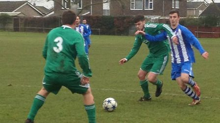 Action from Watton United's 3-0 win over Wells Town Reserves in the quarter-finals of the CS Morley
