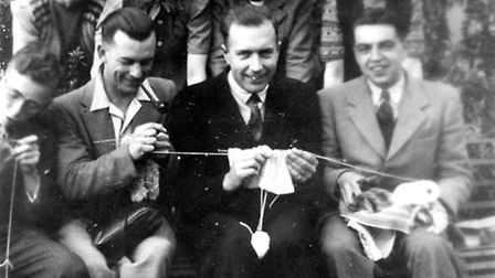 The chaps having a go at knitting in the Young People's Club at St Augustine's Hall in Norwich.