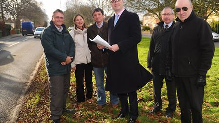 Norfolk County Councillor Ian Mackie, centre, with town and district councillors and campaigners on