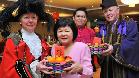 Lord Mayor of Norwich Judith Lubbock and The Sheriff William Armstrong present oranges and money to