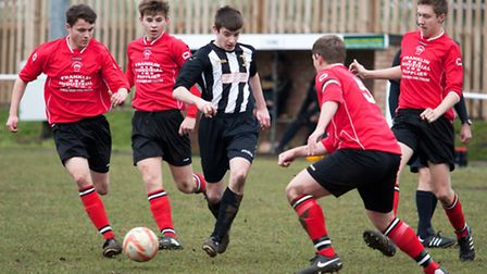 Action from Swaffham Town Reserves' 2-1 loss to Downham Town Reserves (red) at Shoemakers Lane - Luk
