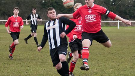 Action from Swaffham Town Reserves' 2-1 loss to Downham Town Reserves (red) at Shoemakers Lane - Ste