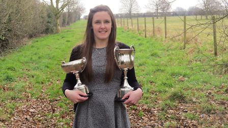 Anne-Marie Wright with two cups she has been awarded for being named the UK's top animal health advi