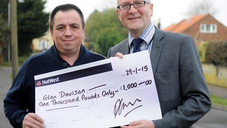 Glen Davison receives a cheque for £1,000 from Archant's David Galletly.Picture: ANTONY KELLY