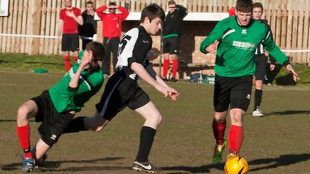 Action from Swaffham Town Reserves' 3-0 home defeat to Blofield United Reserves (green), Luke Reed r