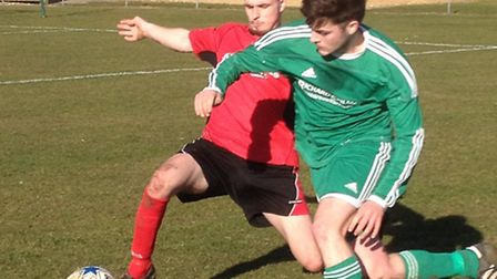 Action from Watton United's CS Morley Cup semi-final against Long Stratton Reserves (red).