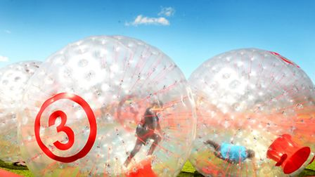 Zorbing at a previous Mile Cross community festival at Sloughbottom Park.