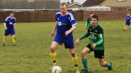 Action from Watton United's (green) 5-0 win at Feltwell.