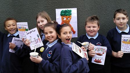 Pupils at Wayland Junior Academy with their cookery book Souperia.