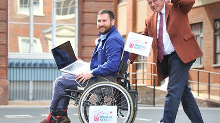 """Musical Keys programme manager Oliver Payne and chairman Ken Shelton with the """"Musical Chairs"""" wheel"""
