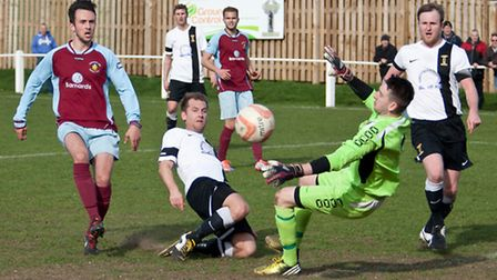 Action from Swaffham Town's 1-1 draw with Stowmarket (red) at Shoemakers Lane, Jack Redhead just sho
