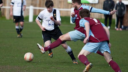 Action from Swaffham Town's 1-1 draw with Stowmarket (red) at Shoemakers Lane, substitute Luke Reed