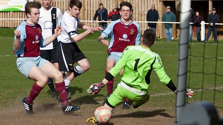 Action from Swaffham Town's 1-1 draw with Stowmarket (red) at Shoemakers Lane, the Stowmarket keeper