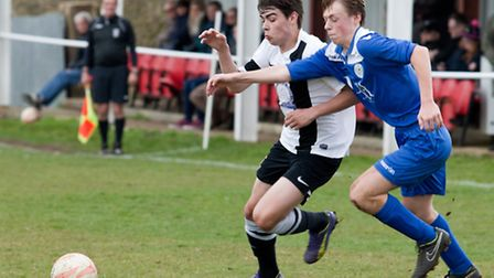 Action from Swaffham Town's 3-1 home win against Cornard United (blue) at Shoemakers Lane, Dylan Edg