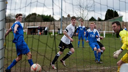 Action from Swaffham Town's 3-1 home win against Cornard United (blue) at Shoemakers Lane, Matthew C