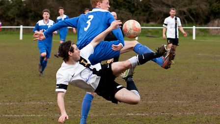 Action from Swaffham Town's 3-1 home win against Cornard United (blue) at Shoemakers Lane, Swaffham