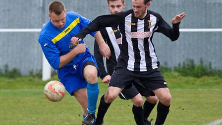 Action from Swaffham Town Reserves' 2-2 draw with Fakenham Town Reserves (blue) at Shoemakers Lane -