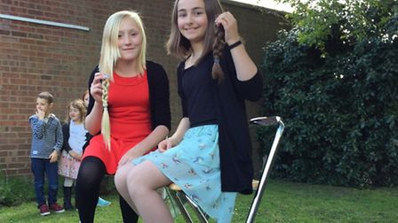 After the haircut - Close friends Poppy Southgate, 11, and Rebecca Hague, 10, who have cut their hai