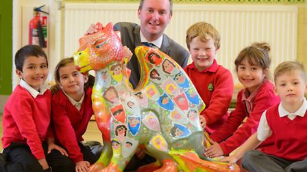 Colman Infant School pupils with their baby GoGoDragon! and Chris Ellis from Dipples who has sponsor