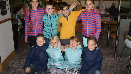 Photo of the Belarussian children wearing their new jackets.