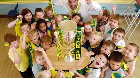 Pupils of Henderson Green Primary School getting close to Norwich City Football Club's prized play o