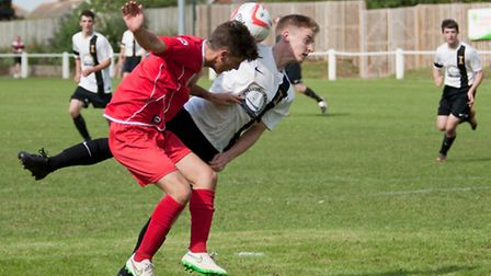 Action from Swaffham Town's 2-2 draw with FC Clacton at Shoemakers Lane, Nick Castellan in aerial ac