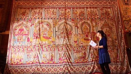 Sadacc Trust collections curator Amy Chang with a huge early-mid 20 century wall hanging from Gujara