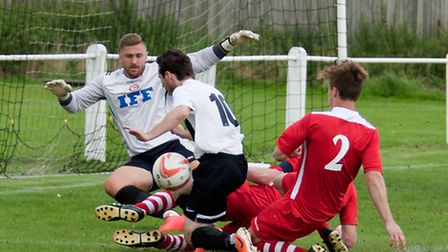 Alex Vincent is bundled off the ball for Swaffham in their 2-2 draw with Haverhill Rovers at Shoemak