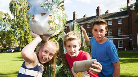 Oscar, Honey and Arthur Pope on the GoGoDragons! trail in Cathedral Close.