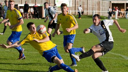 Action from Swaffham Town's 4-0 loss to Long Melford at Shoemakers Lane, Billy Russell letting the t