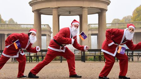Ready for the Santa Run around Eaton Park in aid of EACH, are from left, Lucy Whigham, James Bacon,