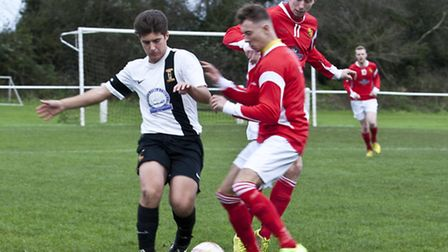 Action from Swaffham Town's 1-1 home draw with Mildenhall (red) at Shoemakers Lane, Joseph Porter ch
