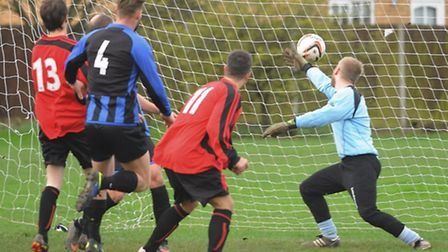 Action from Division 2B of the Norwich Sunday League, Silver Fox (blue) V Cellar House (red). Cellar