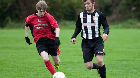 Action from Swaffham Town Reserves' 5-0 home loss to Long Stratton Reserves (red) at Shoemakers Lane