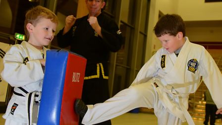 Norwich Choi Kwang Do martial arts group, who received money from Comic Relief, train using shield e
