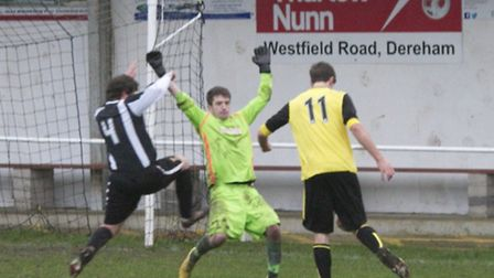 Action from Swaffham Town Reserves home victory over South Walsham at Shoemakers Lane, goalkeeper Aa