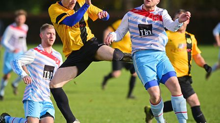 SNS Utd (blue) v Winfarthing football action at Thorpe High School.Picture: ANTONY KELLY