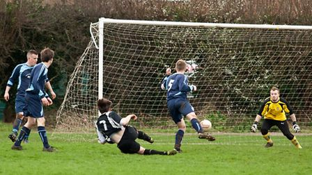 Action from Swaffham Town Reserves' 3-3 draw with Buxton at Shoemakers Lane, Luke Reed fires goalwar