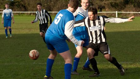 Action from Swaffham Town Reserves against Loddon United Reserves (blue) at Shoemakers Lane, James T