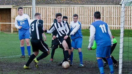Action from Swaffham Town Reserves against Loddon United Reserves (blue) at Shoemakers Lane, Robson